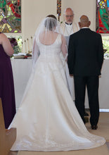 Load image into Gallery viewer, Private Collection 'Lace Overlay Sleeveless' size 14 used wedding dress back view on bride