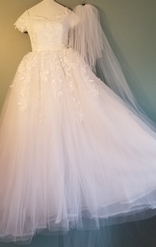 Custom 'Classic' size 2 used wedding dress front view on hanger