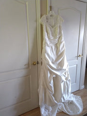 David's Bridal 'Cap Sleeve Satin' size 18 new wedding dress front view on hanger