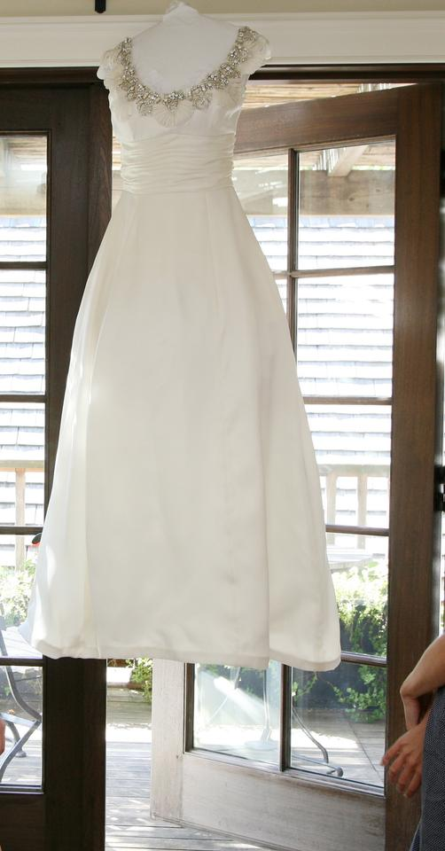 Monique Lhuillier 'Rihanna' size 4 used wedding dress front view on hanger