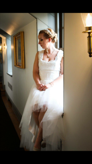Gloss House by Nada 'Custom' size 10 used wedding dress front view on bride