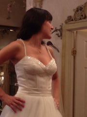 Rina Di Montella 'Beaded Corset' size 4 sample wedding dress front view close up on bride