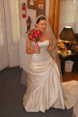 Custom 'Gorgeous Italian Silk' size 4 used wedding dress front view on bride
