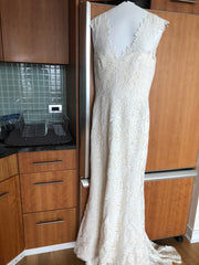 Amy Kuschel 'Avalon Flower Power' size 12 used wedding dress front view on hanger