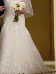 Allure Bridals 'Ivory Gold Lace' size 4 used wedding dress front view on bride