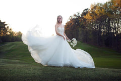 Dennis Basso 'Ball Gown' size 0 used wedding dress side view on bride