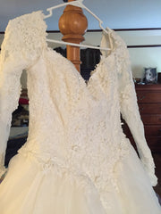 Emmanuelle 'Ball Gown' size 12 used wedding dress front view on hanger