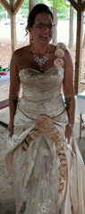 Custom 'Champagne' size 10 used wedding dress front view on bride