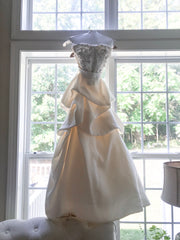 Monique Lhuillier 'Meringue' size 4 used wedding dress front view on hanger