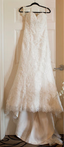 Sottero and Midgley 'Suzette' size 10 used wedding dress front view on hanger