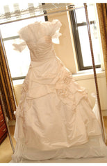 Monique Lhuillier 'Camelot' size 8 used wedding dress front view on hanger
