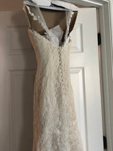 Load image into Gallery viewer, Essense of Australia 'Romantic Vintage Lace' size 8 used wedding dress back view on hanger