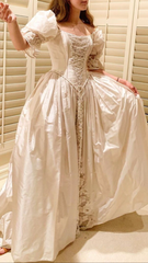 Custom 'Romantic' size 4 used wedding dress side view on bride