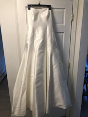 Augusta Jones 'Sweetheart Fit and Flare' size 16 used wedding dress front view on hanger