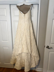 Vera Wang 'Ivory Strapless' size 12 used wedding dress back view on hanger