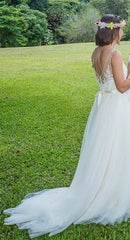 BHLDN 'Cassia' size 2 used wedding dress side view on bride