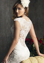 Load image into Gallery viewer, Allure Bridals 'Last Minute Bride' size 2 used wedding dress back view on model