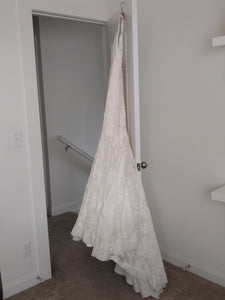 Allure Bridals '9000' size 8 used wedding dress side view on hanger