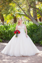 Allure Bridals 'C244' size 10 used wedding dress front view on bride