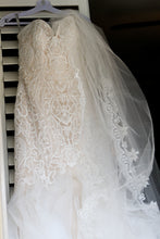 Load image into Gallery viewer, Madison James 'Champagne Mermaid' size 8 used wedding dress front view on hanger