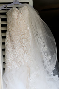 Madison James 'Champagne Mermaid' size 8 used wedding dress front view on hanger