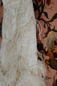 Marchesa 'Ostrich Feathered' size 4 used wedding dress close up view of feathers