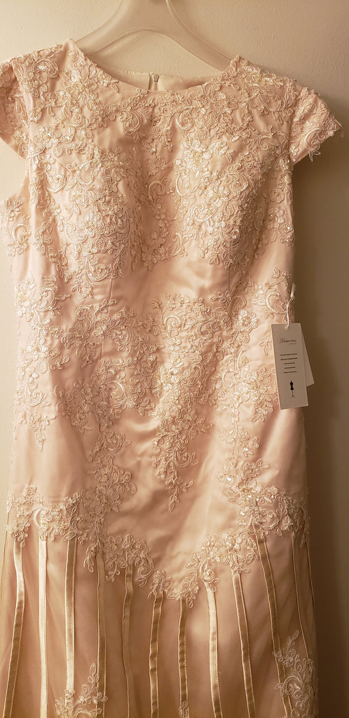 Custom 'Column Lace' size 16 new wedding dress back view on hanger