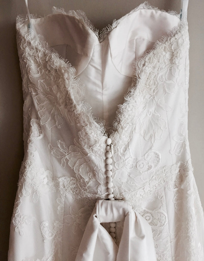 Modern Trousseau 'Beaded Dove' size 6 new wedding dress back view close up on hanger