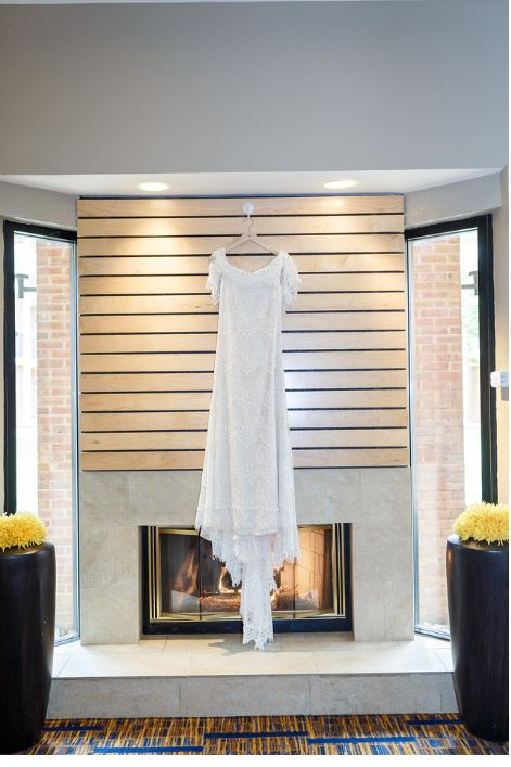 Daughters of Simone 'Joplin' size 12 used wedding dress front view on hanger