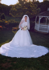 Eve of Milady 'Princess' size 8 used wedding dress front view on bride