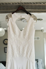 Carol Hannah 'Pemberley' size 12 sample wedding dress front view on hanger