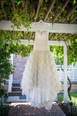 Kenneth Pool 'Fashionista' size 6 used wedding dress front view on hanger