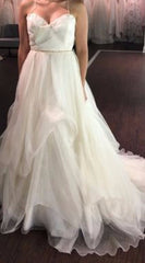 Rivini 'Custom' size 6 sample wedding dress front view on bride