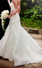 Melissa Sweet 'Mila' size 4 used wedding dress side view on bride