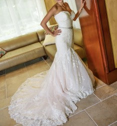 Madison James '215' size 4 used wedding dress side view on bride