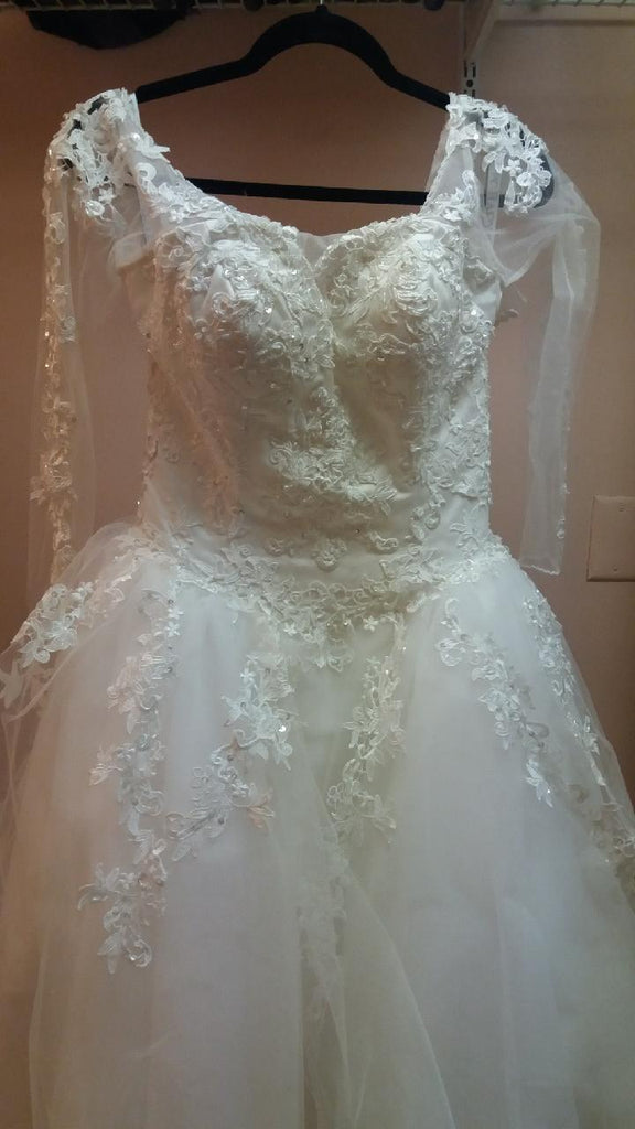 Mary's Designer 'Claudia' size 10 used wedding dress front view on hanger