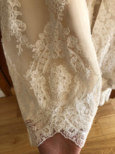 Load image into Gallery viewer, Maggie Sottero 'Viera' size 10 used wedding dress view of hemline
