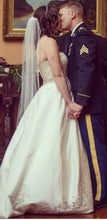 Load image into Gallery viewer, Oleg Cassini 'CYP368' size 8 used wedding dress side view on bride