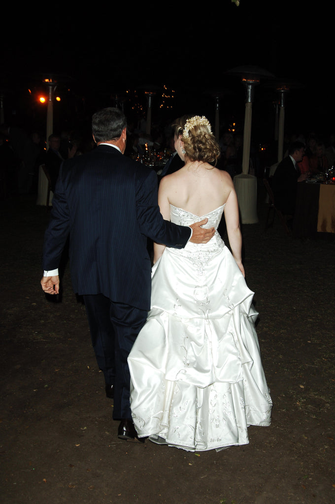 Custom 'Strapless Beaded' size 4 used wedding dress back view on bride