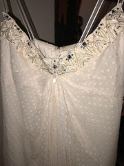 Carolina Herrera 'Chiffon' size 12 used wedding dress close up front view on hanger