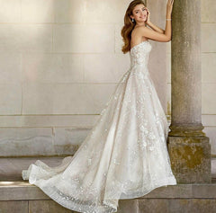Mon Cheri Bridal 'Coda' size 8 new wedding dress side view on model