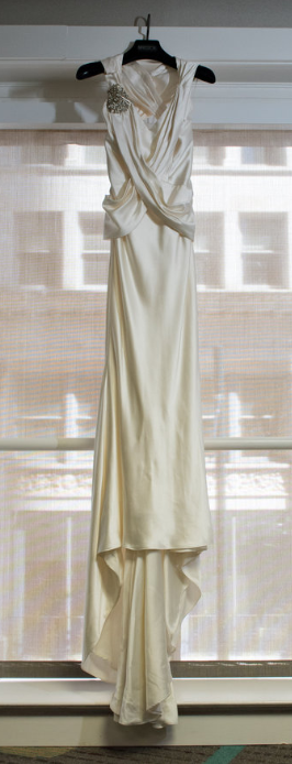 Elizabeth Fillmore 'Exquisite' size 8 used wedding dress front view on hanger
