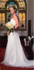 David's Bridal 'Beaded' size 0 used wedding dress side view on bride