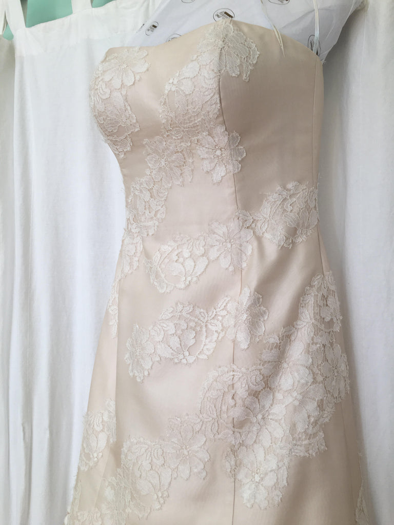 L'Ezu Atelier of Beverly Hills 'Custom' size 8 used wedding dress front view close up on hanger