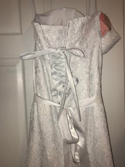David's Bridal 'Sweetheart' size 14 used wedding dress back view on hanger