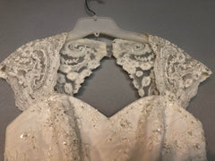 David's Bridal 'Tulle Over Satin' size 8 used wedding dress close up view of bodice