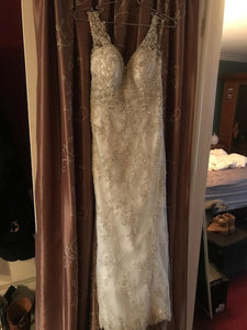 Maggie Sottero 'Greer' size 2 used wedding dress front view on hanger
