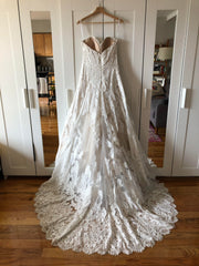 Watters 'Lyric 3012B' size 12 used wedding dress back view on hanger