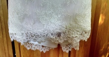 Load image into Gallery viewer, Paloma Blanca 'Strapless Ivory' size 4 used wedding dress view of hemline
