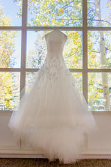Monique Lhuillier 'Veronique' size 4 used wedding dress front view on hanger
